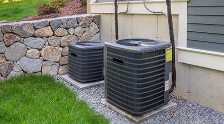 two residential exterior ac units